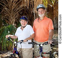 feliz, ciclistas, sênior