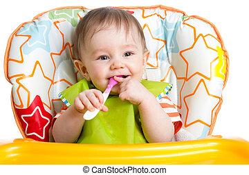 feliz, criança bebê, sentar cadeira, com, um, colher