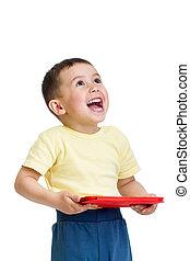 feliz, criança, menino, tocando, com, pc, tabuleta, e, olhar