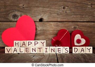 feliz, día de valentines, bloques de madera, con, rojo, corazones, contra, un, rústico, madera, plano de fondo