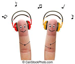 feliz, dedos, en, auriculares