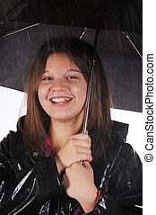 feliz, en la lluvia
