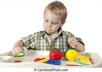feliz, filho jogando, com, plasticine