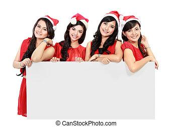 feliz, gente divertida, con, navidad, santa sombrero, tenencia, blanco, bandera, y, actuación, blanco, plano de fondo