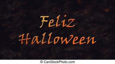 Feliz Halloween text in Spanish dissolving into dust to...