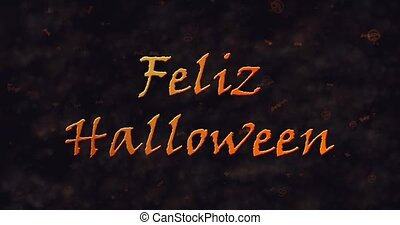 Feliz Halloween text in Spanish dissolving into dust to bottom