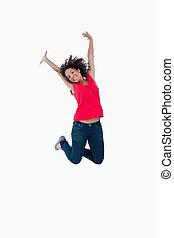 feliz, mujer joven, saltar aire
