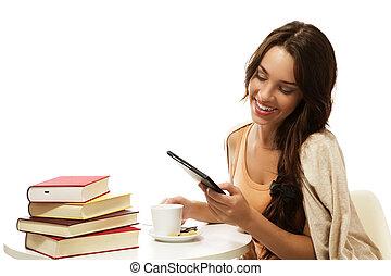 feliz, mulher jovem, leitura, ebook, perto, livros, branco,...