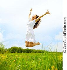 feliz, mulher jovem, pular, azul, sky., beleza, menina, tendo divertimento