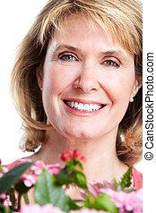 feliz, mulher sênior, com, flowers.