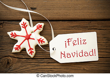 Feliz Navidad, which is Spanish and means Merry Christmas, on a Label with a red white Christmas Star Cookie
