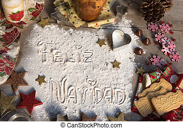 Feliz Navidad, spanish text made with flour, surrounded by...