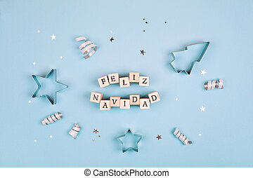 Feliz Navidad text on pastel blue background