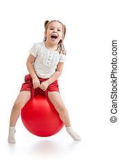 feliz, niño, saltar, en, botar, ball., aislado, blanco