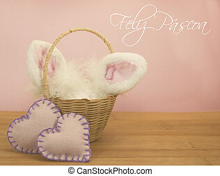 Feliz Pascoa is Happy Easter in Portuguese. Bunny ears and...