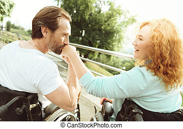 Fell in love mature man kissing hand of woman