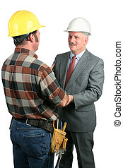 Fellowship At Work 1 - two construction workers greeting...