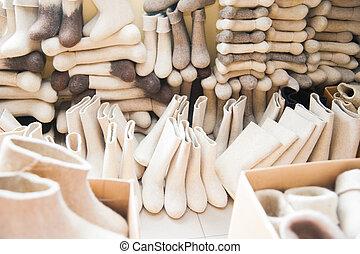 Felt boots on market stand
