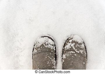 felt boots on snow background