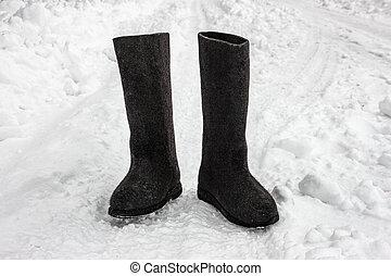 Felt boots on the snow. Russian footwear - valenki