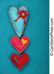 Felt craft and art three stitched hearts on blue