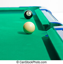 Felt Pool Table - Game of pool being played on felt table