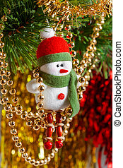 Felt snowmen on Christmas tree. Decoration for New Year celebration.