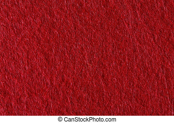 Felt texture in red color useful for christmas backgrounds.