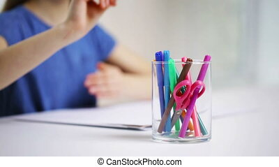 felt-tip pens in glass and girl drawing on paper - people,...