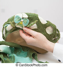 Felting activity - felted hat in woman's hands