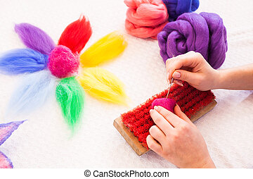 Felting activity, woman working with a felting needle and ...