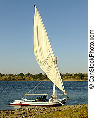 Felucca boat on the Nile river bank, Aswan, Egypt