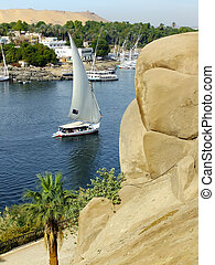 Felucca boat sailing on the Nile river, Aswan, Egypt