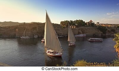 Beautiful landscape with felucca boats on Nile river in Aswan at sunset, Egypt, 4k