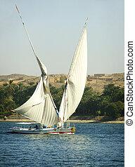 Felucca boats sailing on the Nile river, Aswan, Egypt