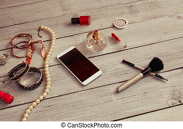 Female accessories on a white wooden background