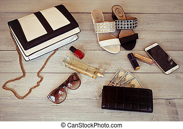 Female accessories on a white woode