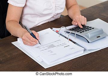 Accountant Calculating Bills - Female Accountant Calculating...