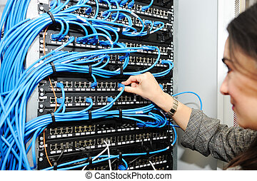 Female administrator at server room