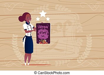 Female African American Cook Holding Best Chef Award Happy Cartoon Chief In Restaurant Uniform Over Wooden Textured Background