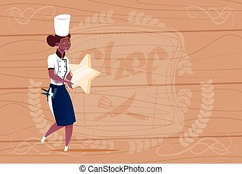 Female African American Cook Holding Star Best Chef Award Happy Cartoon Chief In Restaurant Uniform Over Wooden Textured Background
