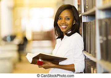 female african american student in university library