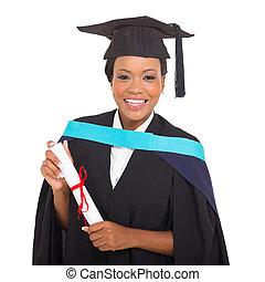 female african college graduate holding certificate