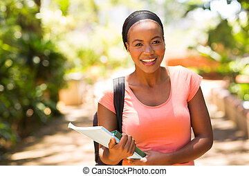 female african college student going to class
