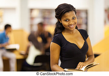 female african college student in library