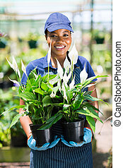 female african florist portrait