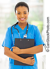 female african medical nurse holding clipboard