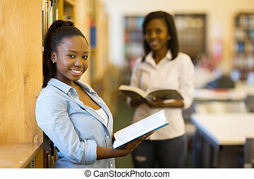 female african uni student in labrary
