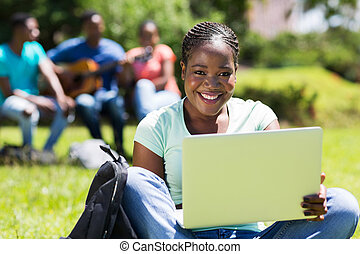 female afro american college student with laptop computer