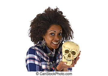 Female afro american woman with human skull model